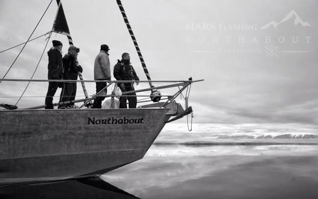 Northabout between icy waters